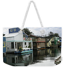 Weekender Tote Bag featuring the photograph Reflections Of Colored Houses   by Haleh Mahbod