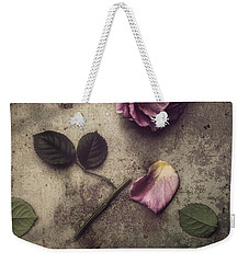 Weekender Tote Bag featuring the photograph Remnants by Amy Weiss