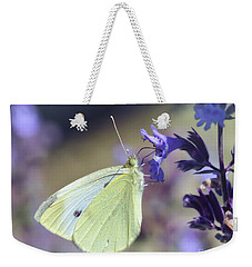 Weekender Tote Bag featuring the photograph Resting In The Purple by Kerri Farley