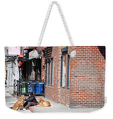Weekender Tote Bag featuring the photograph Resting On The Corner by Rob Hans