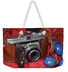 Weekender Tote Bag featuring the photograph Retina by John Schneider