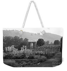 Weekender Tote Bag featuring the photograph Retreat by Eric Liller