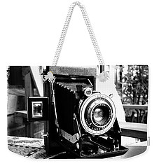 Weekender Tote Bag featuring the photograph Retro Camera by Daniel Dempster