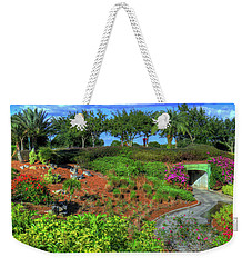 Weekender Tote Bag featuring the photograph Reunion Resort  by Tom Prendergast