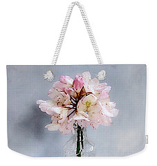 Weekender Tote Bag featuring the photograph Rhododendron Bloom In A Glass Bottle by Louise Kumpf