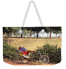 Weekender Tote Bag featuring the photograph Rickshaw Rider Relaxing by Travel Pics