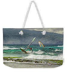 Weekender Tote Bag featuring the photograph Riders On The Storm by Susan Rissi Tregoning