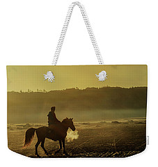 Weekender Tote Bag featuring the photograph Riding His Horse by Pradeep Raja Prints