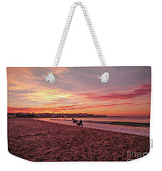 Weekender Tote Bag featuring the photograph Riding Home by Roy McPeak