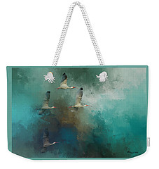 Weekender Tote Bag featuring the photograph Riding The Winds by Marvin Spates