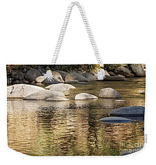 Weekender Tote Bag featuring the photograph Ripples And Rocks by Linda Lees