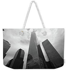 Weekender Tote Bag featuring the photograph Risen Out Of The Rubble by John Schneider