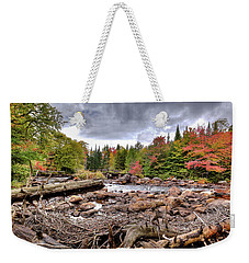 Weekender Tote Bag featuring the photograph River Debris At Indian Rapids by David Patterson