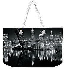 Weekender Tote Bag featuring the photograph River Lights In Black And White by Frozen in Time Fine Art Photography