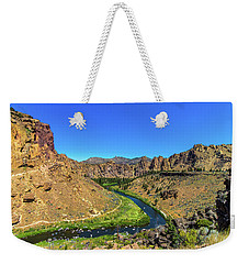 Weekender Tote Bag featuring the photograph River Through Mountains by Jonny D