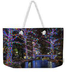 Weekender Tote Bag featuring the photograph Riverwalk Christmas by Steven Sparks