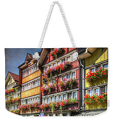 Weekender Tote Bag featuring the photograph Row Of Swiss Houses by Hanny Heim
