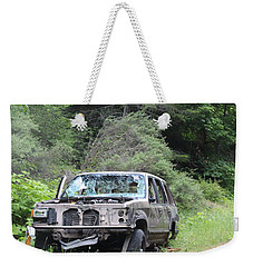 Weekender Tote Bag featuring the photograph Road Kill by Marie Neder