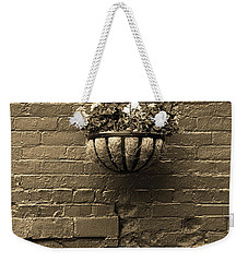 Weekender Tote Bag featuring the photograph Rochester, New York - Wall And Flowers Sepia by Frank Romeo