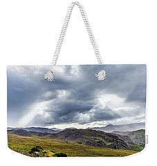 Weekender Tote Bag featuring the photograph Rock Formation Landscape With Clouds And Sun Rays In Ireland by Semmick Photo