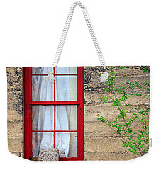 Weekender Tote Bag featuring the photograph Rock On A Red Window by James Eddy