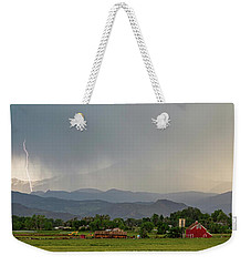 Weekender Tote Bag featuring the photograph Rocky Mountain Storming Panorama by James BO Insogna