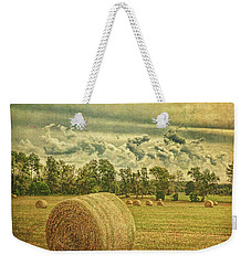 Weekender Tote Bag featuring the photograph Rollin' Hay by Lewis Mann
