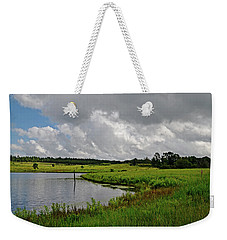 Weekender Tote Bag featuring the photograph Rollin' In by Linda Brown