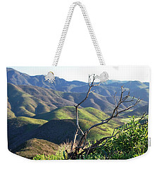 Weekender Tote Bag featuring the photograph Rolling Green Hills With Dead Branches by Matt Harang