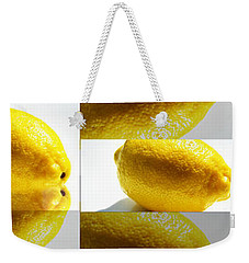 Weekender Tote Bag featuring the photograph Rolling Lemons by Tina M Wenger