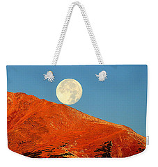 Weekender Tote Bag featuring the photograph Rolling Moon by Karen Shackles
