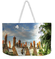 Weekender Tote Bag featuring the photograph rooftops Hogsmeade by Tom Prendergast