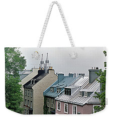 Weekender Tote Bag featuring the photograph Rooftops by John Schneider