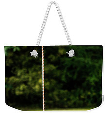 Weekender Tote Bag featuring the photograph Rope Swing  by Shelby Young