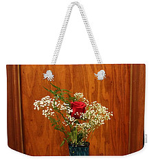 Weekender Tote Bag featuring the photograph Rose In A Glass Vase Before by Marie Neder