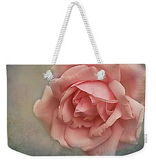 Weekender Tote Bag featuring the photograph Rose New Dawn by Jacqi Elmslie