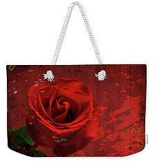 Weekender Tote Bag featuring the photograph Roses Are Still Red by Bonnie Willis