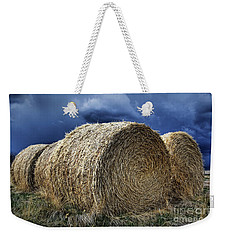 Weekender Tote Bag featuring the photograph Round Bales by Brad Allen Fine Art