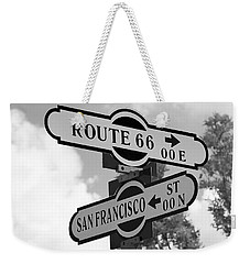 Route 66 Street Sign Black And White Weekender Tote Bag by Phyllis Denton