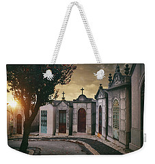 Weekender Tote Bag featuring the photograph Row Of Crypts by Carlos Caetano