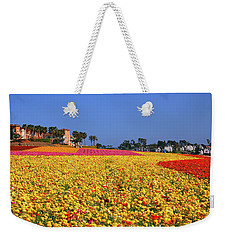 Weekender Tote Bag featuring the photograph Rows In Bloom by James Kirkikis