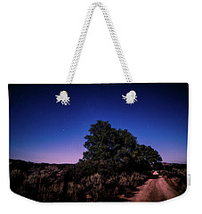 Weekender Tote Bag featuring the photograph Rural Starlit Road by T Brian Jones