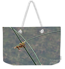 Weekender Tote Bag featuring the photograph Rush by Ann E Robson