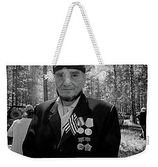 Weekender Tote Bag featuring the photograph Russian Afghanistan War Veteran by John Williams