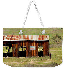 Weekender Tote Bag featuring the photograph Rustic Barn With Flag by Art Block Collections
