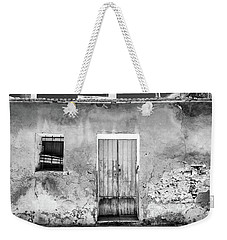 Weekender Tote Bag featuring the photograph Rustic Building. by Gary Gillette