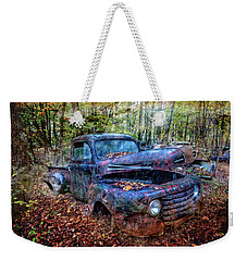 Weekender Tote Bag featuring the photograph Rusty Blue Vintage Ford  Truck by Debra and Dave Vanderlaan