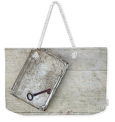 Weekender Tote Bag featuring the photograph Rusty Key On The Old Tattered Book by Michal Boubin