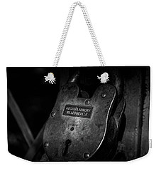 Weekender Tote Bag featuring the photograph Rusty Lock In Bw by Doug Camara