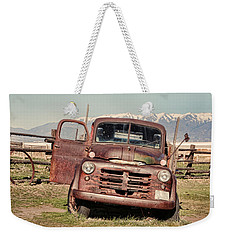 Weekender Tote Bag featuring the photograph Rusty Old Dodge by Ely Arsha